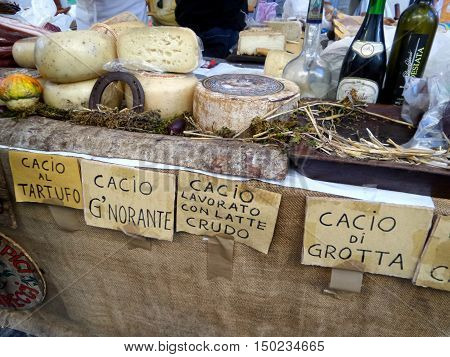 ORIOLO ROMANO, ITALY - SEPTEMBER 25, 2016: Italian cheese, wines and schnapps in sale on stand with the occasion of Porcini Mushrooms Festival.