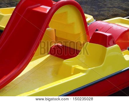 Red-and-yellow paddle boat