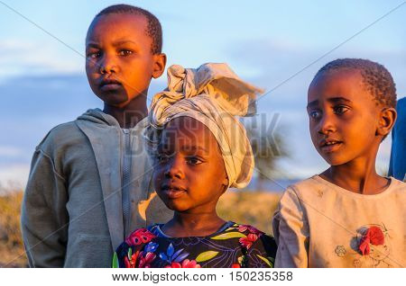 LAKE EYASI, TANZANIA - MAY 29, 2015: Kids from a Datoga tribe playing at sunset at Lake Eyasi Tanzania
