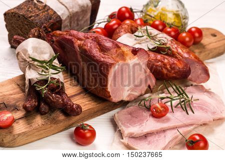 Antipasto Catering Platter With Salami And Meat On A Wooden Background