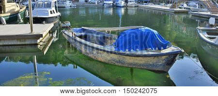 An old wooden boat moored in the harbour of the small town of Skradin on the coast of the Sibenik-Knin County of Croatia