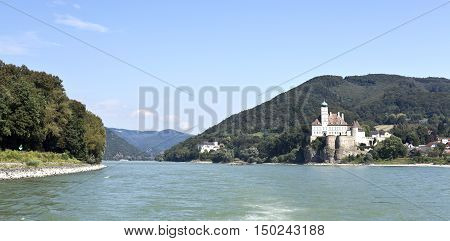 View of Schonbuhel Medieval Castle standing on the edge of a high cliff in the Danube valley of Wachau near Melk Austria.