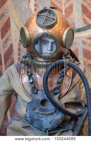 BIARRITZ, FRANCE - JUNE 27, 2016: Old atmospheric diving suit from the 1910s displayed in the Musee de la Mer (Museum of the Sea) in Biarritz, France.