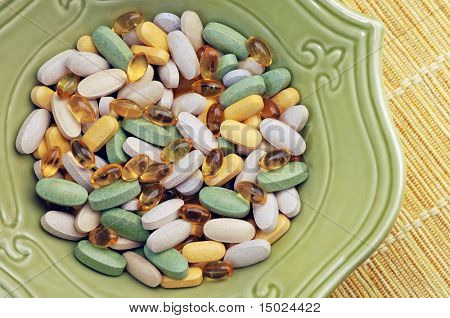 Vitamin Soup: Close-up of assorted nutritional supplements served in a decorative bowl.