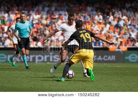 VALENCIA, SPAIN - OCTUBER 2nd: Nani with ball and Lucas during Spanish soccer league match between Valencia CF and Atletico de Madrid at Mestalla Stadium on Octuber 2, 2016 in Valencia, Spain