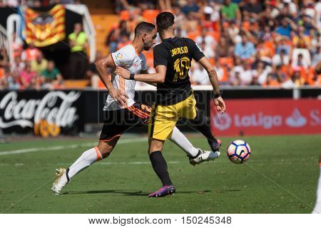 VALENCIA, SPAIN - OCTUBER 2nd: (L) Montoya and Carrasco during Spanish soccer league match between Valencia CF and Atletico de Madrid at Mestalla Stadium on Octuber 2, 2016 in Valencia, Spain