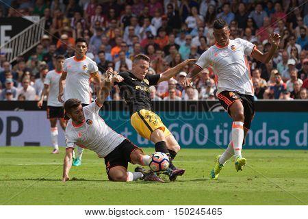 VALENCIA, SPAIN - OCTUBER 2nd: (L) Gaya, 21 Gameiro, 4 Santos during Spanish soccer league match between Valencia CF and Atletico de Madrid at Mestalla Stadium on Octuber 2, 2016 in Valencia, Spain