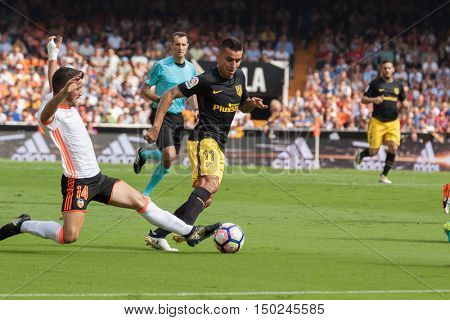 VALENCIA, SPAIN - OCTUBER 2nd: Correa with ball and Gaya during Spanish soccer league match between Valencia CF and Atletico de Madrid at Mestalla Stadium on Octuber 2, 2016 in Valencia, Spain