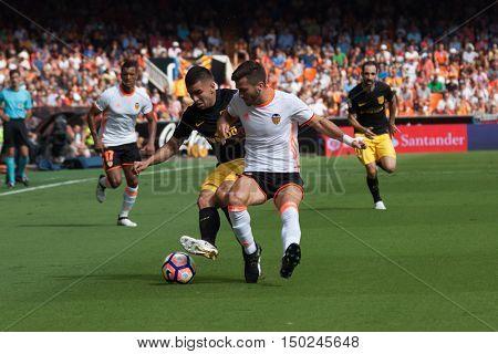 VALENCIA, SPAIN - OCTUBER 2nd: (L) Correa (R) Gaya during Spanish soccer league match between Valencia CF and Atletico de Madrid at Mestalla Stadium on Octuber 2, 2016 in Valencia, Spain