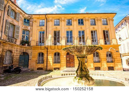 Beautiful old fountain on Albertas square in Aix-en-Provence old town in France. French architecture in Provence
