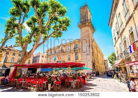 Aix-en-Provence, France - June 20, 2016: Central square with cafes and bars in the old town of Aix-en-Provence city on the south of France.