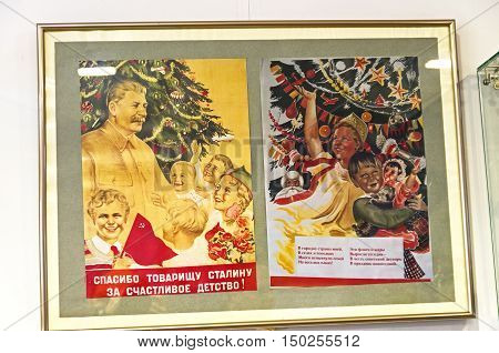 KLIN RUSSIA - JANUARY 16 2016: Reproductions of old Soviet propaganda posters on the theme of Christmas. The slogan on the poster: