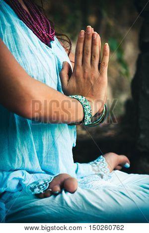 closeup of woman hands practice yoga  in lotus position outdoor shot