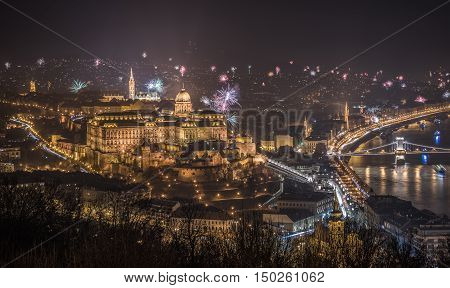 New Year Celebration. Buda Castle or Royal Palace in Budapest Hungary with Fireworks at Night as Seen from Gellert Hill