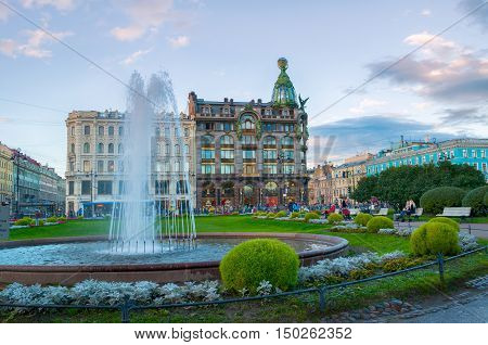 ST PETERSBURG RUSSIA - OCTOBER 3 2016. Zinger House on Nevsky Prospect in the historic center of the city and fountain on the foreground. Autumn evening in St Petersburg center Russia