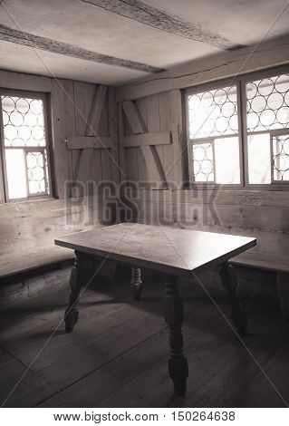 Vintage image of a wooden furnished dining room interior - Retro style image with monochrome settings of an aged dining room interior with wooden furniture walls and floor depicting the rural life in medieval times.