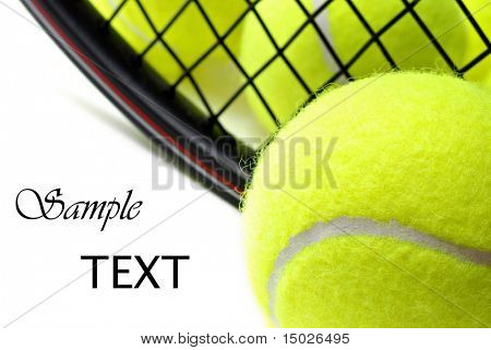 Tennis balls and racquet on white background with copy space.  Macro with shallow dof.