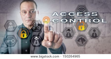 Male corporate administrator activating ACCESS CONTROL onscreen. Information technology metaphor involving identity management computer security selective restriction of access and authorization.