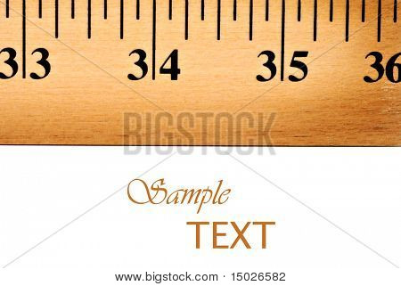 Macro image of wooden yardstick on white background with copy space.