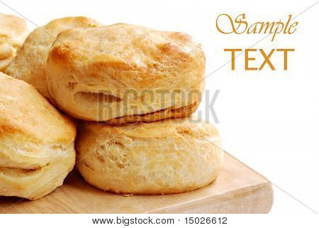 Freshly baked homemade biscuits on white background with copy space.  Macro with shallow dof.