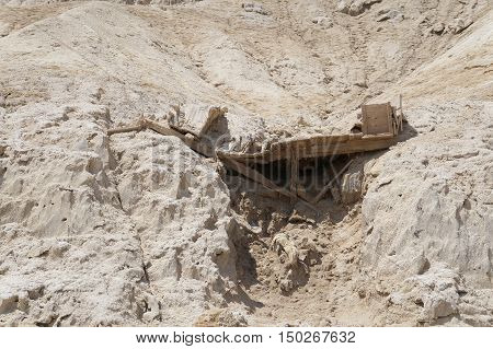 Old abandoned dugout near Dead sea coast