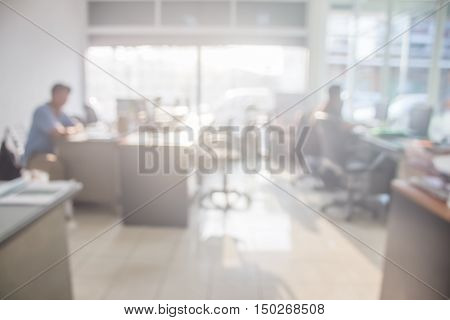 Businessmen blur in the workplace.Table Top And Blur Office of Background.abstract blur background table work in office with computer.Abstract background of office shallow depth of focus.