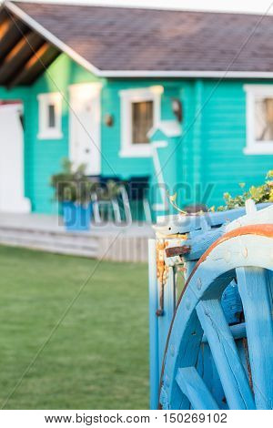 colorful wooden bungalow with old blue wooden wagon Cadiz Spain