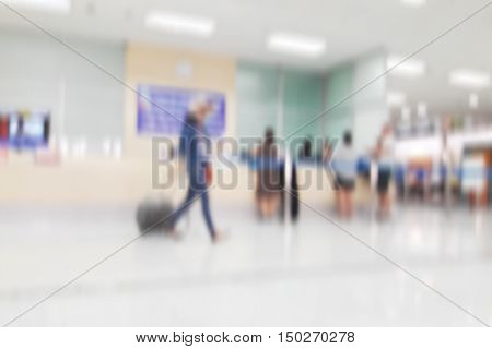 white blurred of department store background. Defocused blur background / Abstract blur shopping mall store interior for background / Corridor in airport out of focus