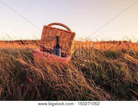 Picnic basket and bottle wine at prince edward island