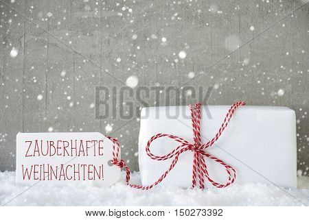 One Christmas Present On Snow. Cement Wall As Background With Snowflakes. Urban Style. Card For Birthday Or Seasons Greetings. Label With German Text Zauberhafte Weihnachten Means Magic Christmas