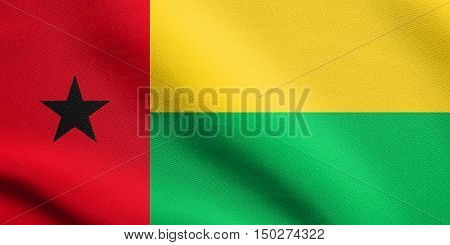 Bissau-Guinean national official flag. African patriotic symbol banner element background. Accurate dimensions. Correct size colors. Flag of Guinea-Bissau waving in wind detailed fabric texture, 3d illustration