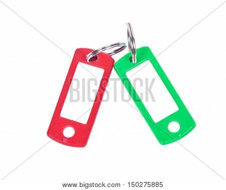 Green and red key holder separated on white background