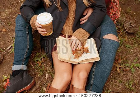 Happy couple in love outdoor. Stunning sensual outdoor portrait of young stylish fashion couple posing in park in autumn