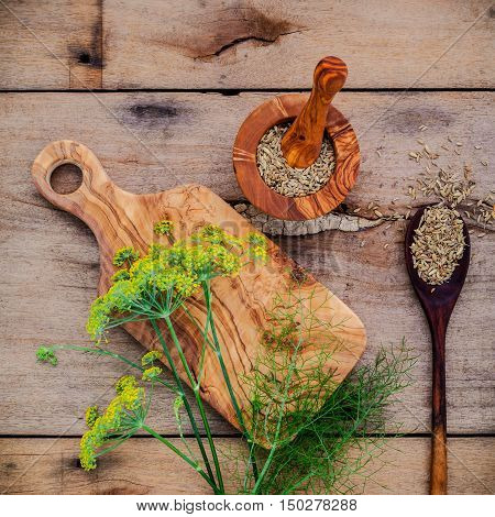 Close Up Blossoming Branch Of Fennel And Dried Fennel Seeds On Rustic Wooden Background With Flat La