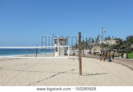 LAGUNA BEACH, CALIFORNIA - OCTOBER 3, 2016: Main Beach. Sand volleyball court, Lifeguard Station and boardwalk are just three of the many atrtactions along the Laguna Coastline.