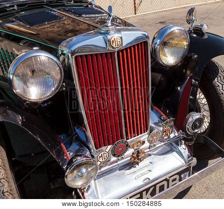 Laguna Beach, CA, USA - October 2, 2016: Black and Red 1947 MG TC classic car owned by Tom Harkenrider and displayed at the Rotary Club of Laguna Beach 2016 Classic Car Show. Editorial use.