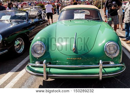 Laguna Beach, CA, USA - October 2, 2016: Green 1957 Porsche 356 A Cabriolet owned by Jonathan Greer and displayed at the Rotary Club of Laguna Beach 2016 Classic Car Show. Editorial use.