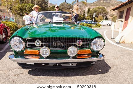 Laguna Beach, CA, USA - October 2, 2016: Green 1972 Triumph TR6 owned by Robert Myer and displayed at the Rotary Club of Laguna Beach 2016 Classic Car Show. Editorial use.