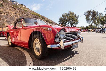 Laguna Beach, CA, USA - October 2, 2016: Red 1967 Triumph TR4A displayed at the Rotary Club of Laguna Beach 2016 Classic Car Show, Editorial use.