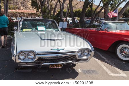 Laguna Beach, CA, USA - October 2, 2016: Silver 1963 Ford Thunderbird owned by Bill Waldmann and displayed at the Rotary Club of Laguna Beach 2016 Classic Car Show. Editorial use.