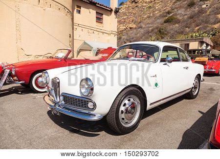 Laguna Beach, CA, USA - October 2, 2016: White 1959 Alfa Romeo Givlietta Sprint owned by Ahmet Tuncay and displayed at the Rotary Club of Laguna Beach 2016 Classic Car Show. Editorial use.