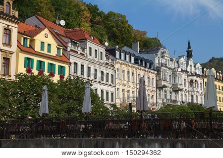 Street with historical buildings and bridge over the river Tepla in Karlovy Vary Czech Republic.