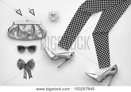 Fashion woman Clothes Accessories Set. Fashion Design Outfit. Black White. Stylish Leggings, Glamor fashion Heels, Handbag Clutch, Trendy Sunglasses. Fashion Cosmetic. Top view. Minimal. Monochrome
