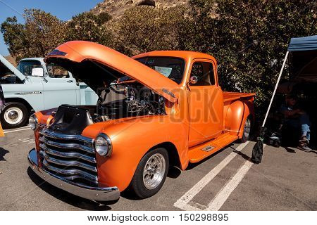 Laguna Beach, CA, USA - October 2, 2016: Orange 1948 Chevy Truck owned by Tim Timmerman and displayed at the Rotary Club of Laguna Beach 2016 Classic Car Show. Editorial use.