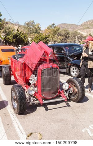 Laguna Beach, CA, USA - October 2, 2016: Red 1932 Ford Hi Boy owned by TJ Fink and displayed at the Rotary Club of Laguna Beach 2016 Classic Car Show. Editorial use.