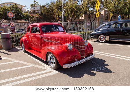 Laguna Beach, CA, USA - October 2, 2016: Red 1939 Chevy Coupe owned by Ken Biggs and displayed at the Rotary Club of Laguna Beach 2016 Classic Car Show. Editorial use.