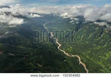 Dry riverbed between the hills. South Kamchatka Nature Park. View from the helicopter.