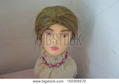 The Head Of A Mannequin On A Table