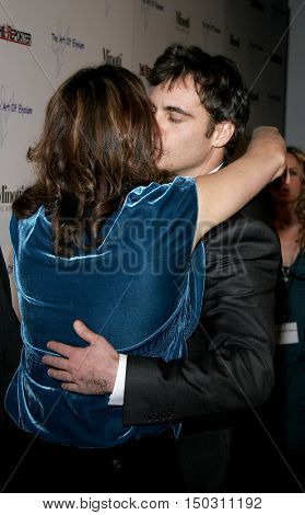Joaquin Phoenix and Jennifer Howell at the Art of Elysium Presents Russel Young 'fame, shame and the realm of possibility' held at the Minotti Los Angeles in West Hollywood, USA on November 30, 2005.