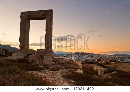 View of Portara and remains of temple of Apollo at sunrise.